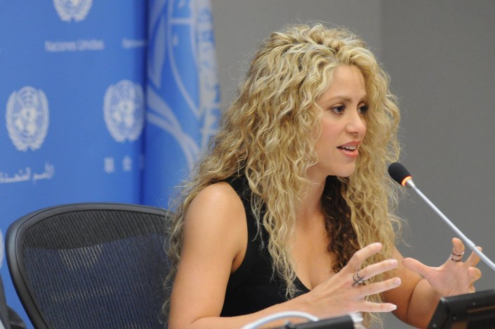 Shakira addresses media during a press conference at the United Nations.