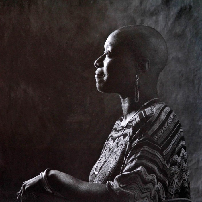 Breast cancer survivor Phyllis Fagan, who lost all of her hair to chemotherapy, sits proudly for a portrait just after she instructed a local barber to shave off what remained of her hair.