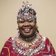 Dorcus Parit, a Masai activist wearing colorful Masai dress.