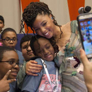 (Right) Performer Chloe Bailey from 'Chloe x Halle' embraces a girl as she is photographed at a rehearsal ahead of Monday's event to mark World Children's Day at the United Nations Headquarters, on 19 November 2017.