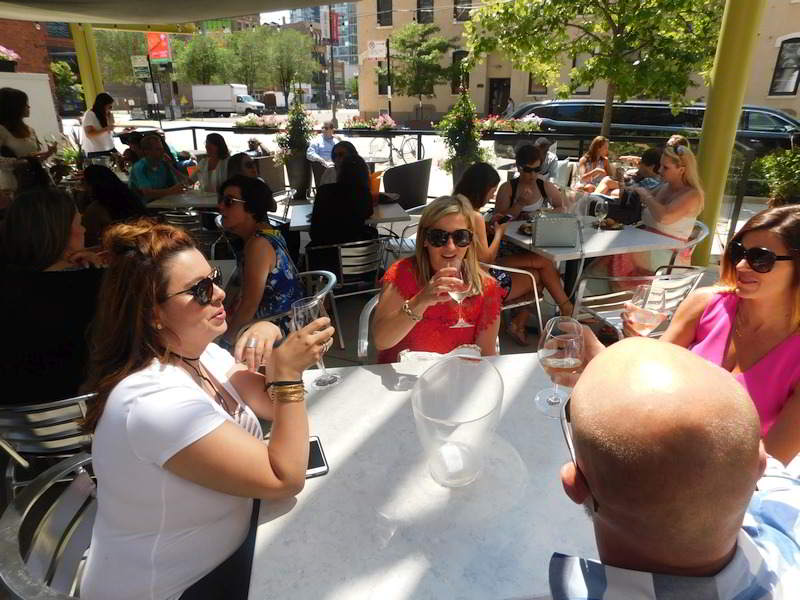 Otdoors at Wine Crawl with stretch limo in background