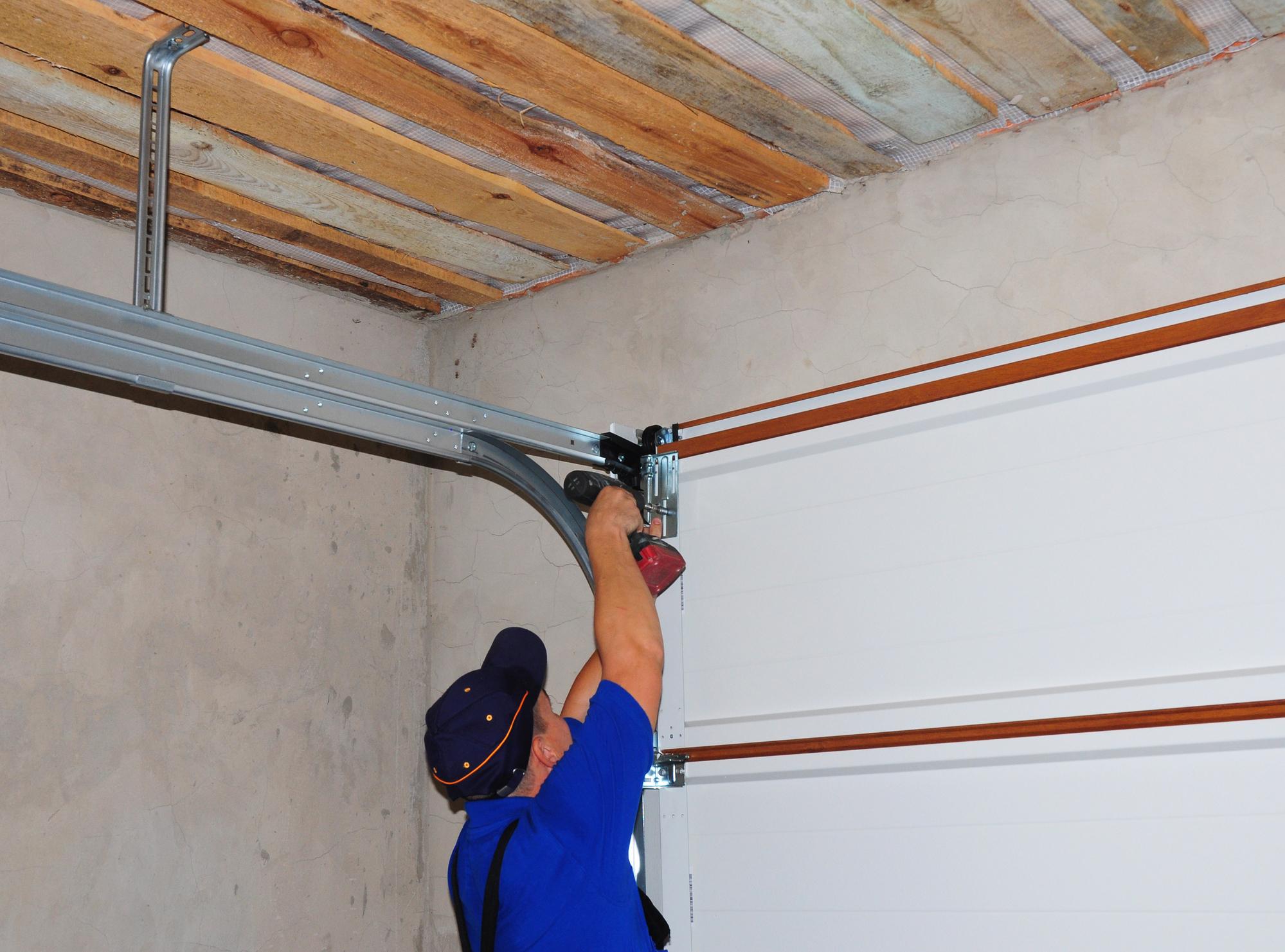 Garage door repair services being performed in Lees Summit, MO