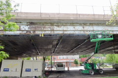 May 2019 - Workers install shielding to collect debris to the underside of the viaduct over Philadelphia's Nicetown section.