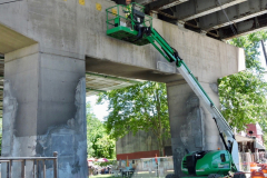 June 2019 - A worker performs repairs on one of the support piers of the Wayne Junction Viaduct.