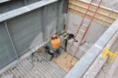 June 2020 - A worker performs repairs on the bridge's steel structural components.