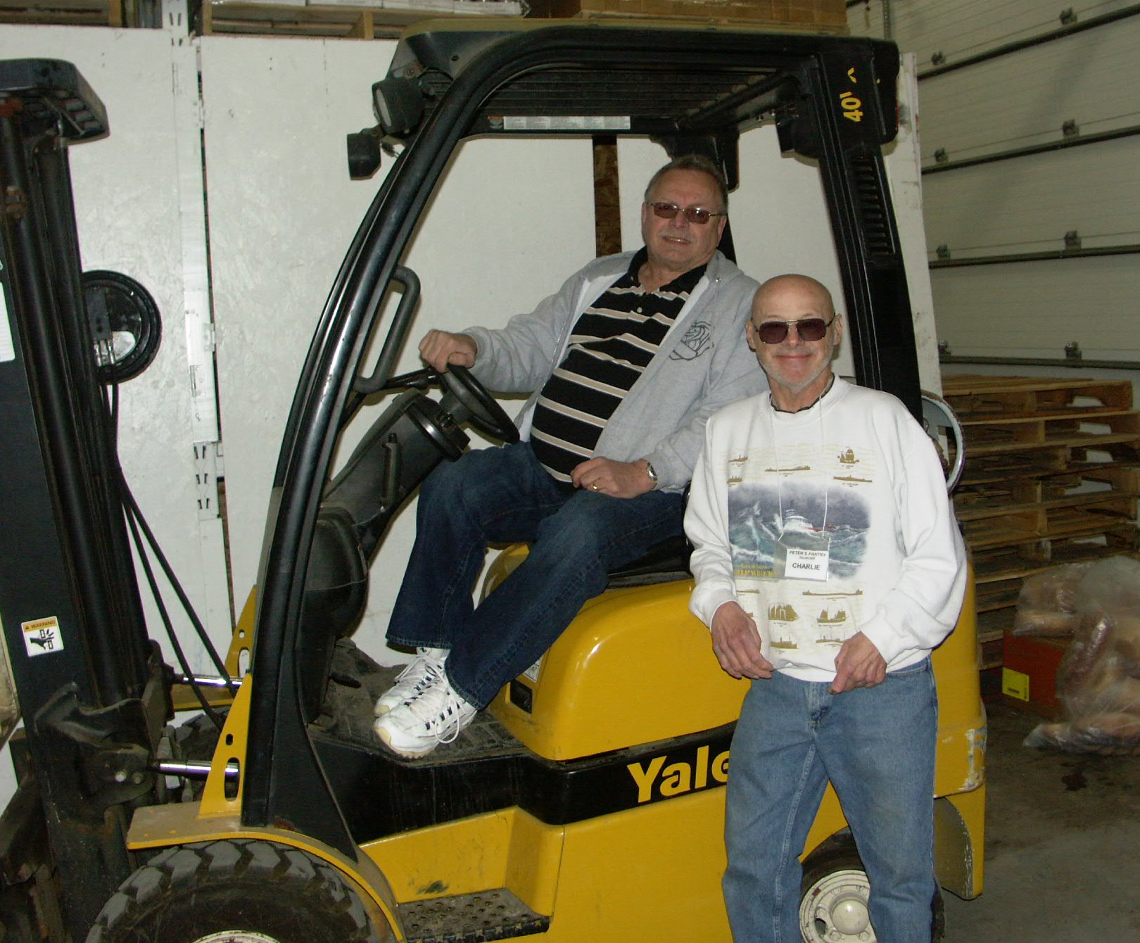 Volunteers with forklift