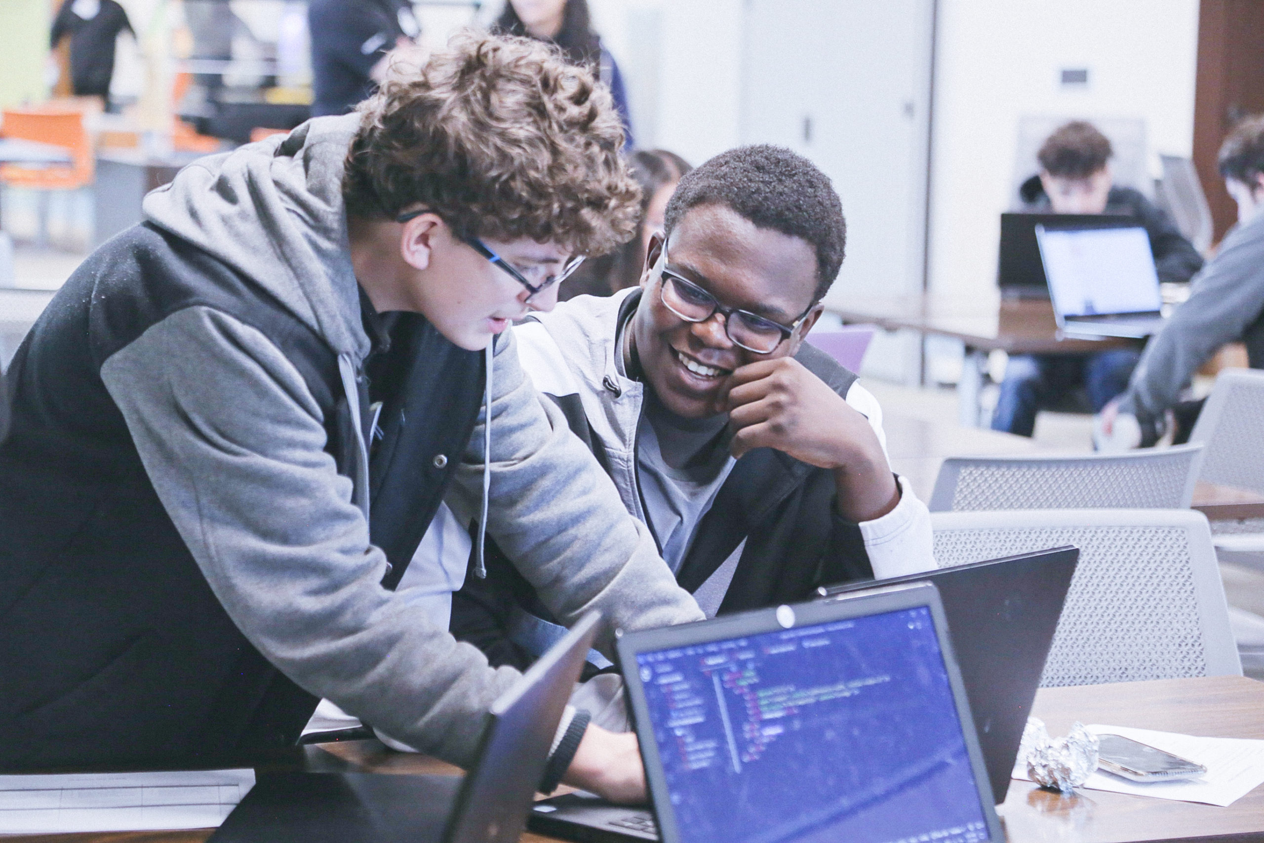 Emmanuel Ahonle (C2C '20) and Samuel Gunter (C2C '20) working together on their technical project at our first Hackathon prepping for Demo Day!