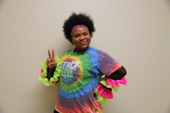 """Senior Quebillah Harvey smiles in her tie die and ruffly sleeves. """"It's senior year,"""" Harvey said, """"Why wouldn't I dress up?"""""""