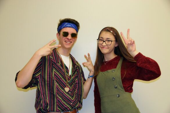 Accidentally matching, senior Vincent and junior Candace Osborn run into their 70's counterpart on their way to lunch.
