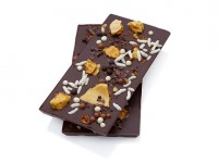 Smooth dark chocolate bar topped with handmade honeycomb, assorted crunchy chocolate balls, puffed rice and crunchy textures. Also available in milk chocolate
