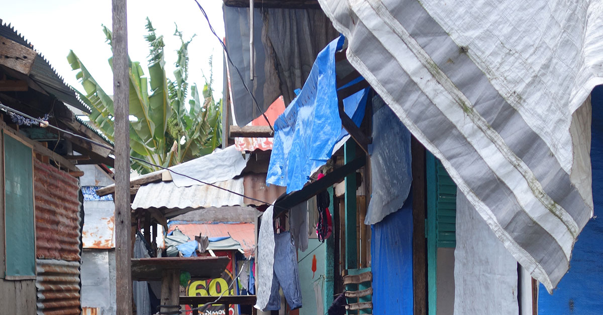 Salvaged materials on walls and roof of houses in informal settlement