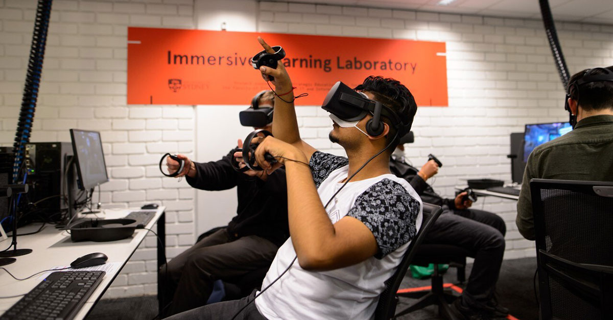 Student pointing up while using virtual reality headset