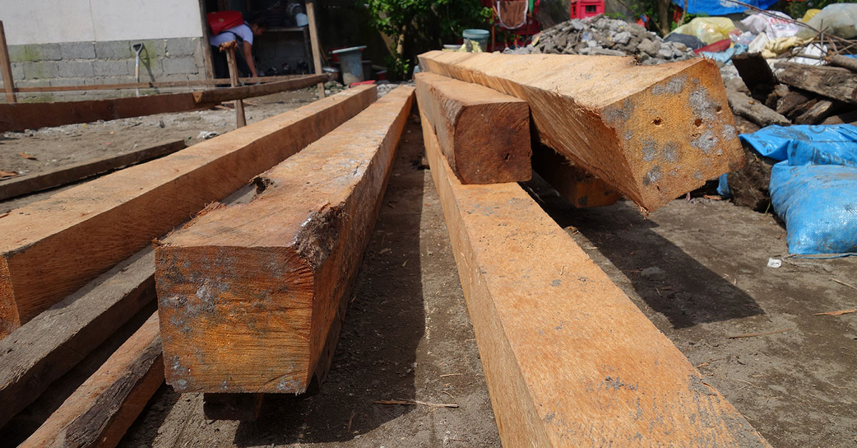 Timber posts laying on ground