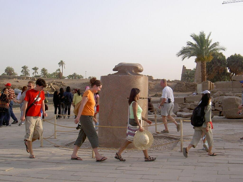 Walking around the Scarab statue in Karnak Temples