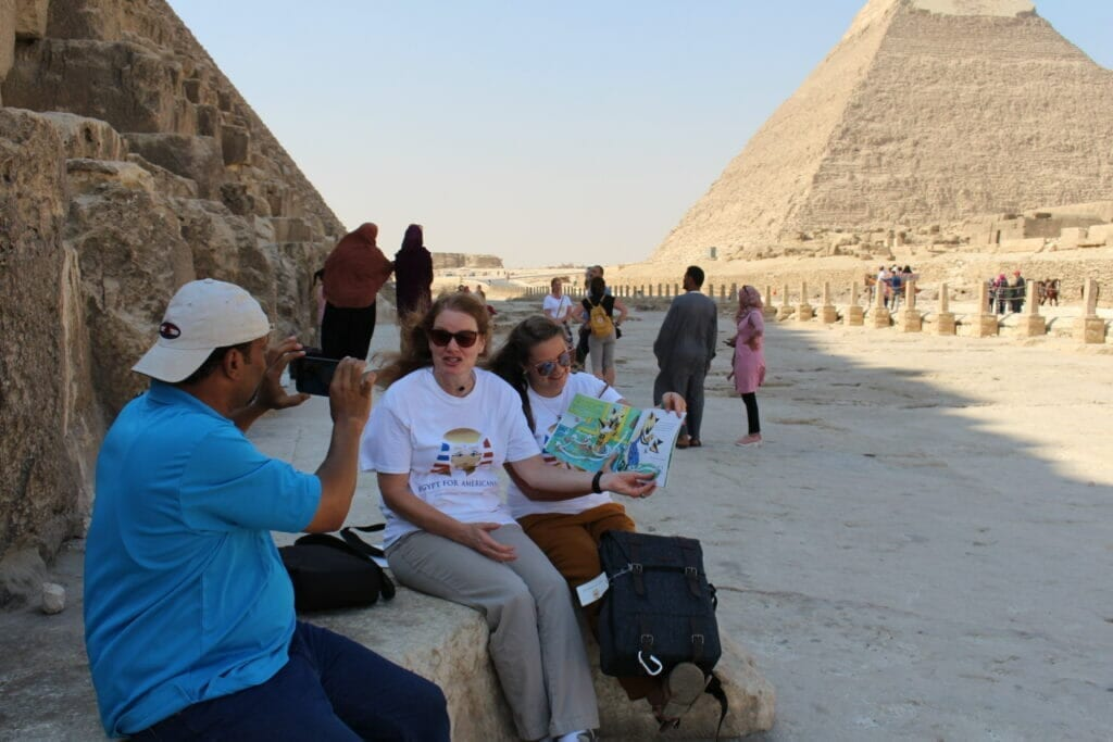 American Teachers at the Pyramids and Sphinx Reading a book to American Students