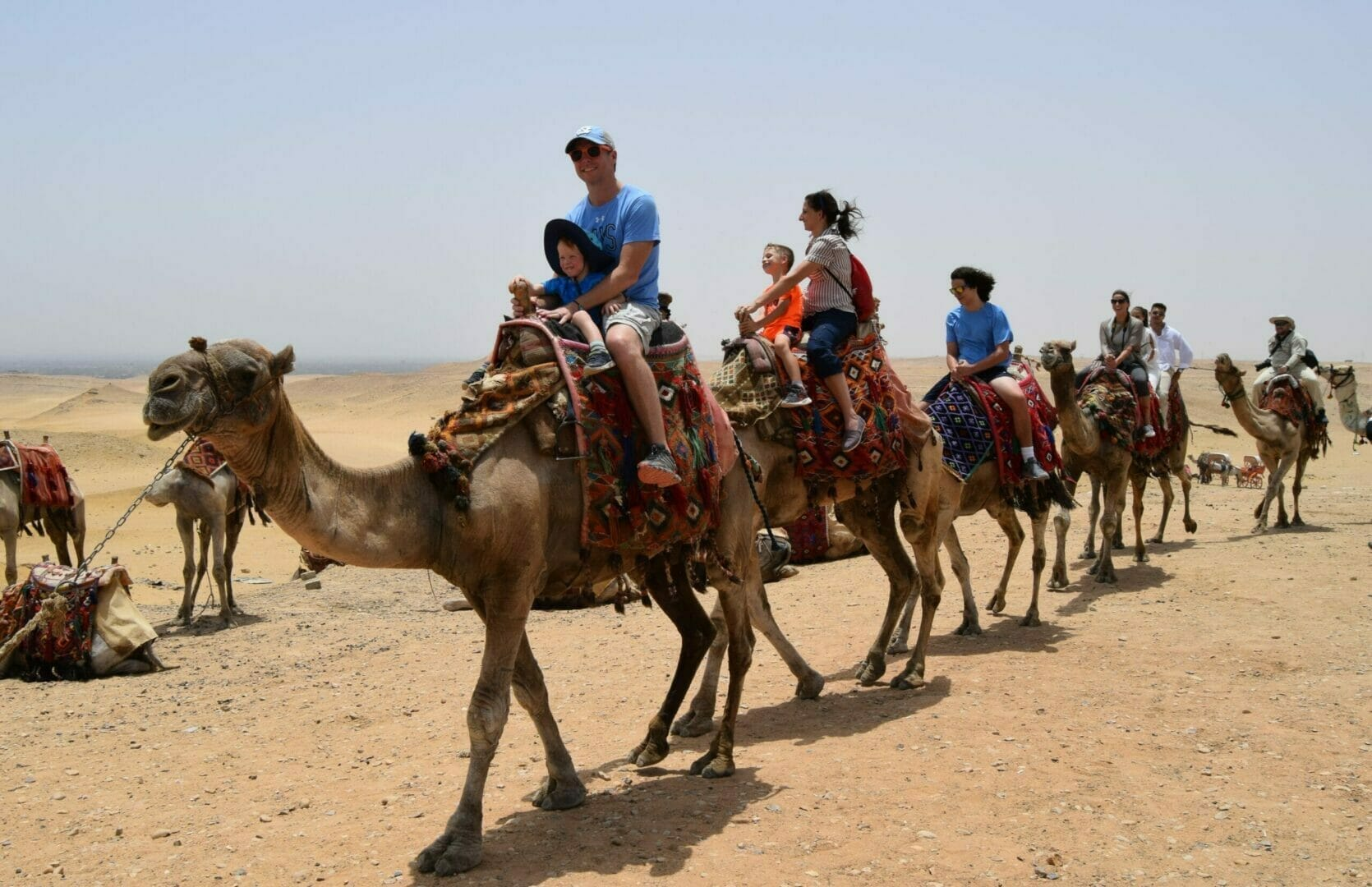Egypt Budget Group Tour Package on camels at the Pyramids
