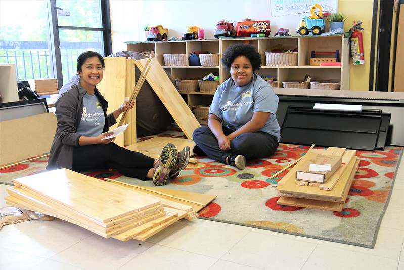 Next Door Solutions to Domestic Violence: Volunteers assemble cabinets