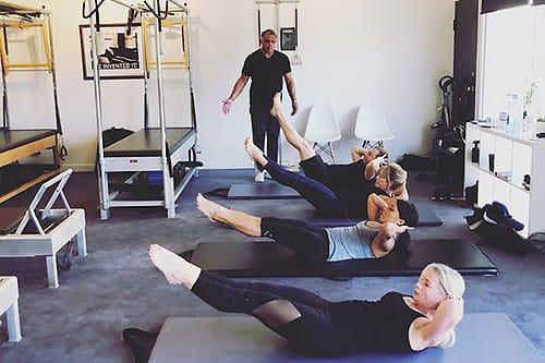 Pilates mat class taught in Santa Monica by Hector Mercado