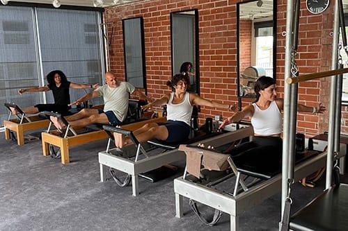 Pilates group reformer equipment class at Phoenix Classical Pilates