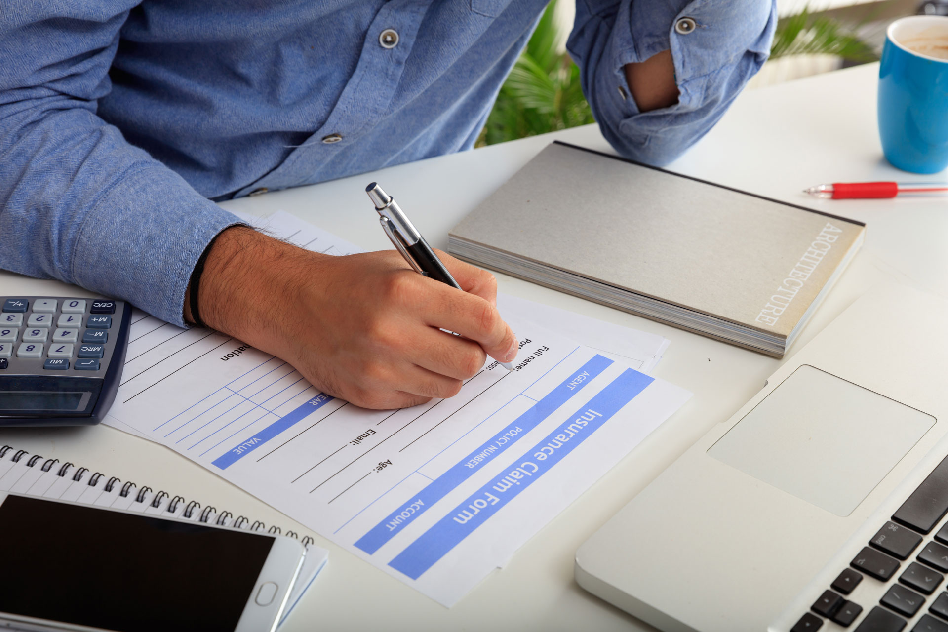 better-accounting-man-preparing-an-insurance-claim-form