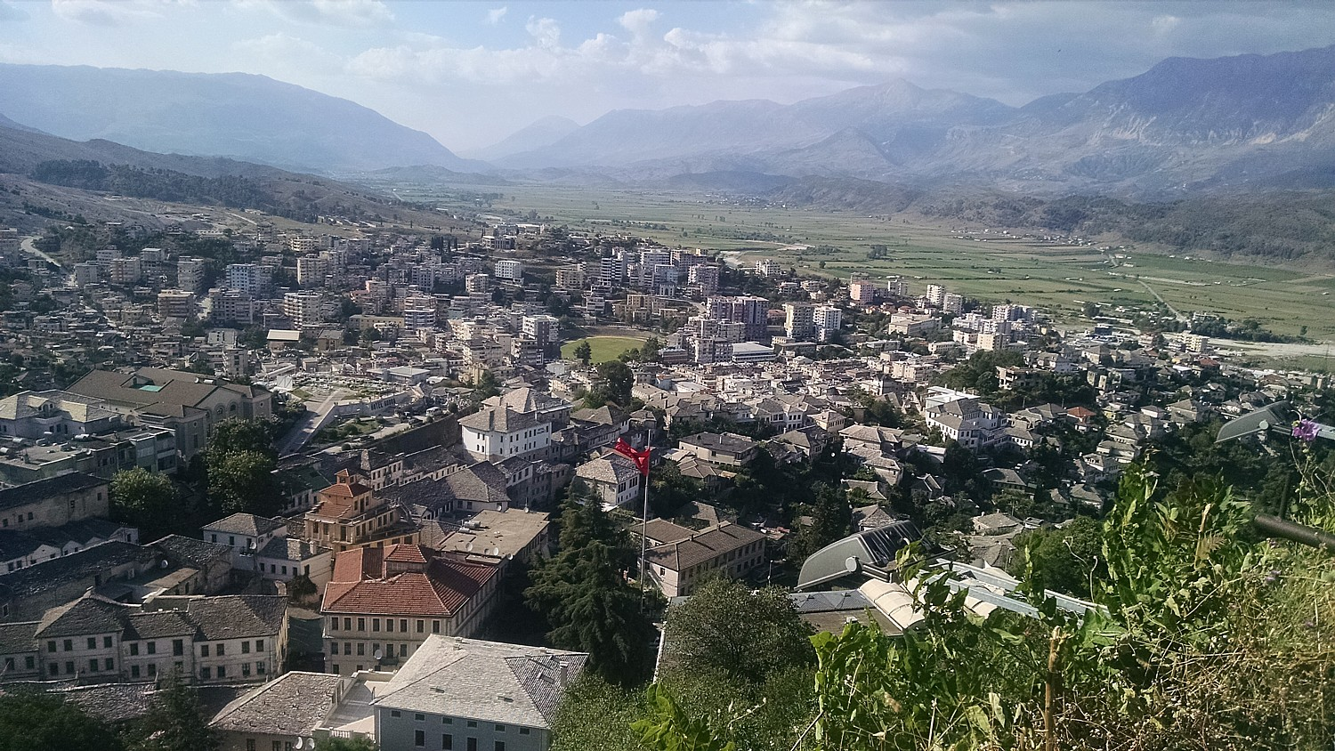 The view from the castle of Gjirokaster, a UNESCO-protected living history city in Albania, overlooks a lush valley © 2016 Karen Rubin/goingplacesfarandnear.com