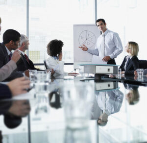 Group of office workers in a boardroom presentation