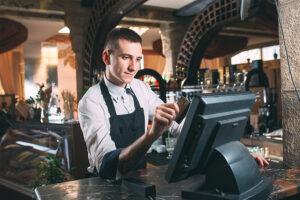 guy swiping credit card at bar