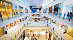blurred retail shopping mall with people on multiple floors