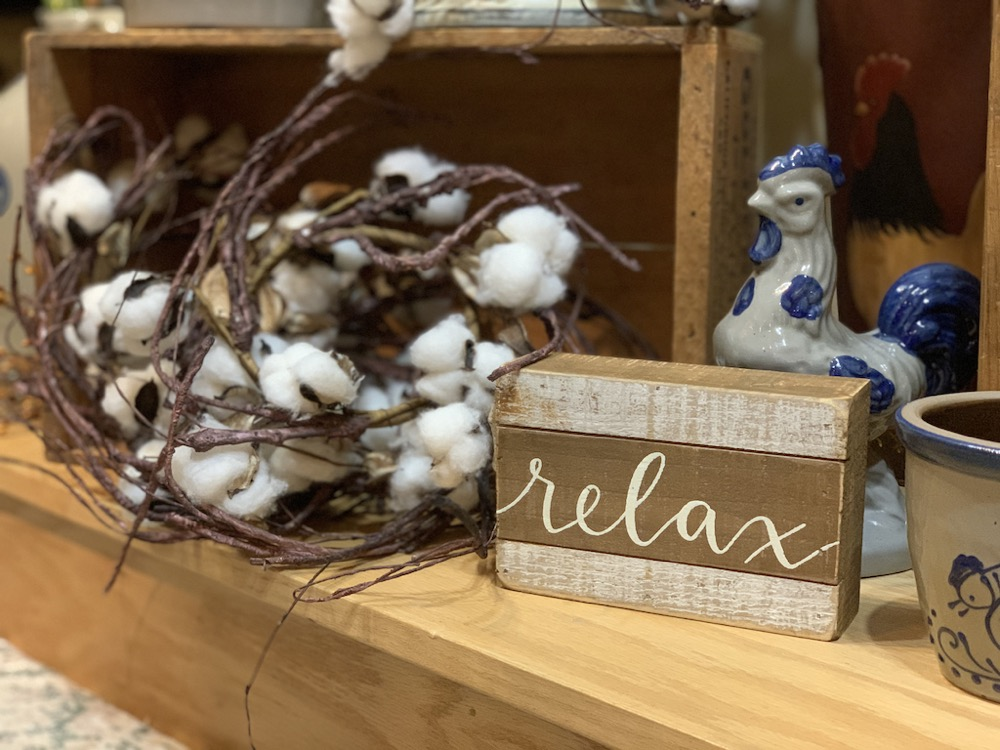 relax wood sign artificial plants and home decor items