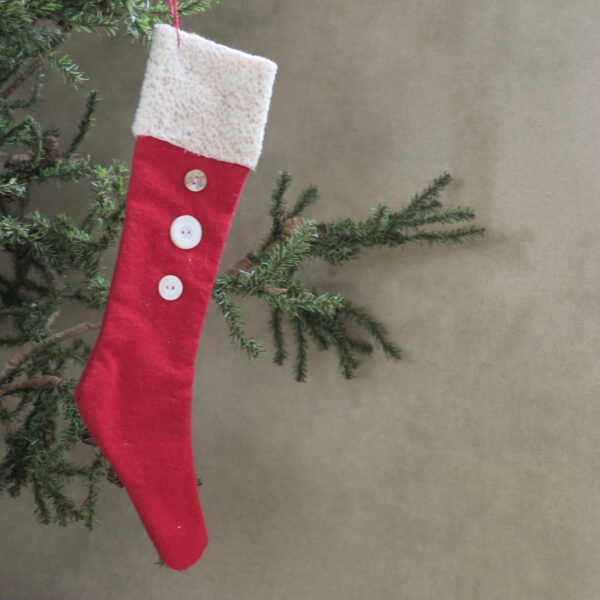 large primitive stocking with fur and vintage buttons