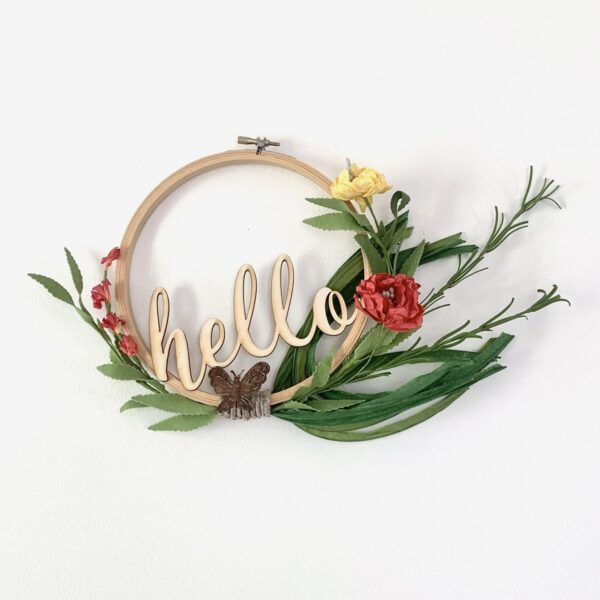 embroidery hoop hello sign with butterfly and bright flowers