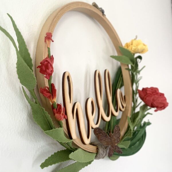 embroidery hoop hello sign with butterfly and bright flowers angle