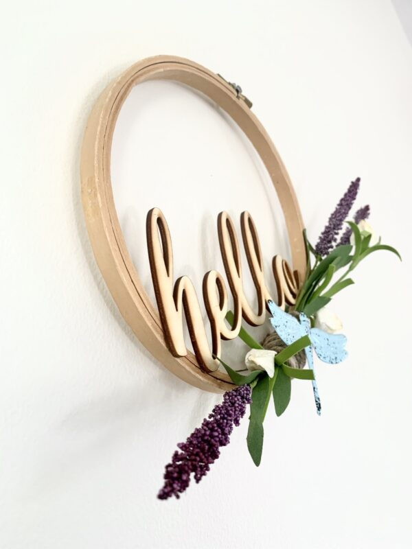 embroidery hoop hello sign with dragonfly and lavender sprigs angle