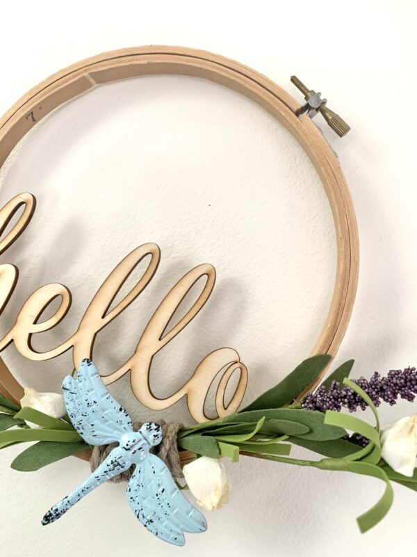 embroidery hoop hello sign with dragonfly and lavender sprigs close up