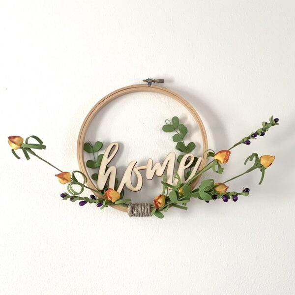 embroidery hoop home sign with orange flowers