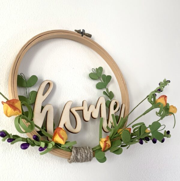 embroidery hoop home sign with orange flowers angle