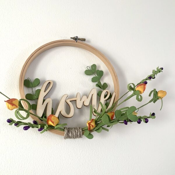 embroidery hoop home sign with orange flowers close up