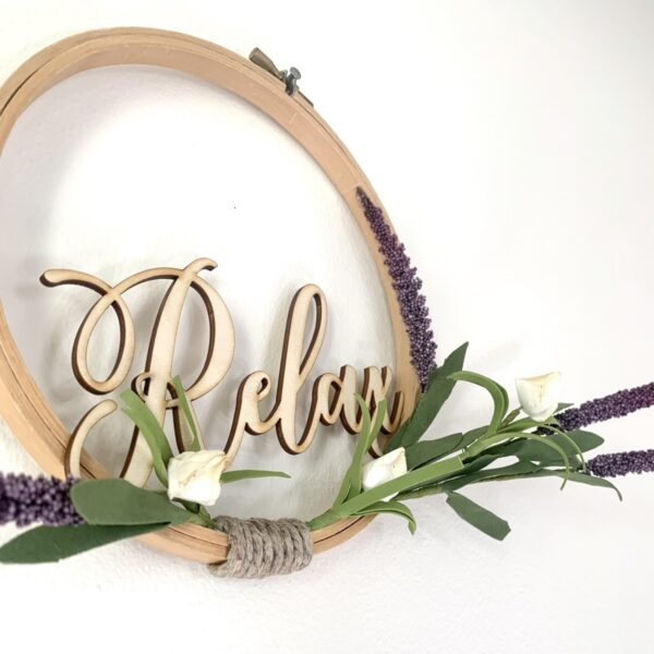 embroidery hoop relax sign with lavender and white flowers close up