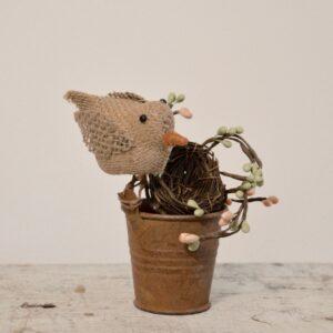 Primitive Bird with Nest in Rusty Bucket