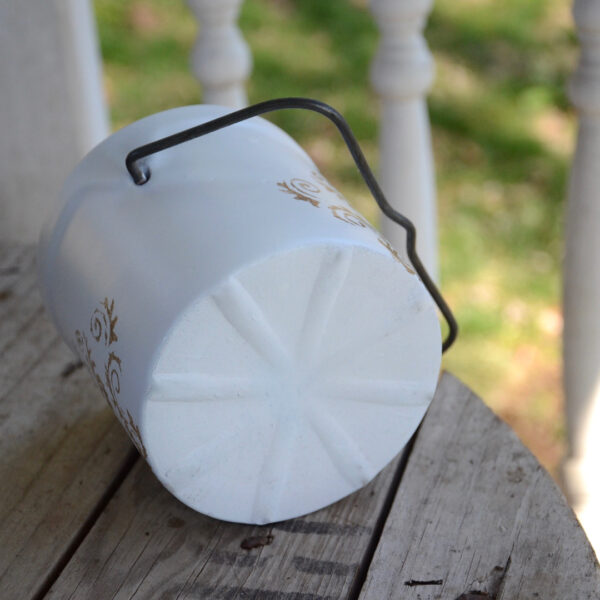 butter crock repurposed into a planter painted white with metallic decorative stencil bottom view