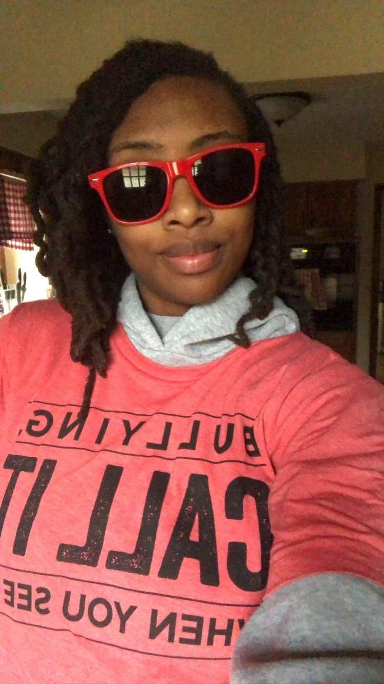 A woman from Banneker Elementary wearing sunglasses during Bully Awareness Spirit Week