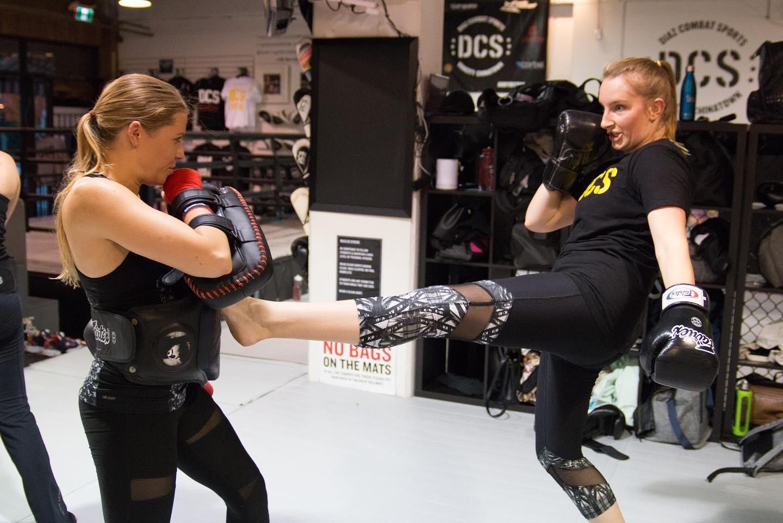 Practicing teep kicks at Vancouver kickboxing classes