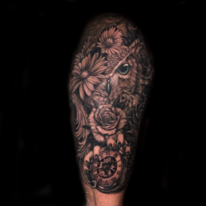 Best Black & Gray owl and flowers Tattoo in Los Angeles Matt Hildebrand