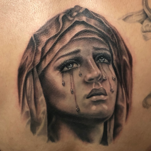 Best Black And Gray Religious Icon Tattoos in Northridge