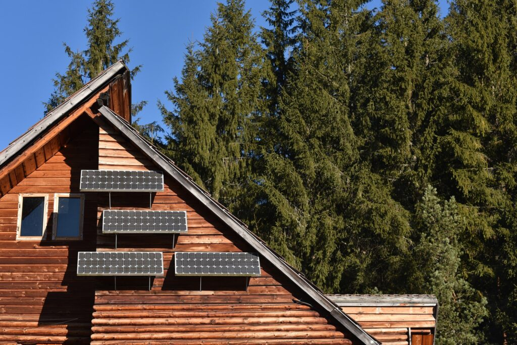 Solar panel on a wooden cottage in the forest