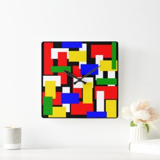This image has an empty alt attribute; its file name is Red-Yellow-Black-Blue-and-Green-Blocks-wall-clock-1.jpg