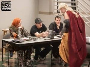Salt Lake Comic Con technical judges Kamui Cosplay, Aaron Forrester and Daniel Falconer checking out the details of a contestant's costume and giving personal feedback. Photograph courtesy Robert Hirschi, official cosplay competition photographer.