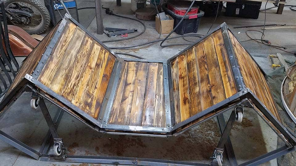 stained wood surfaces of new custom table for BladeHQ