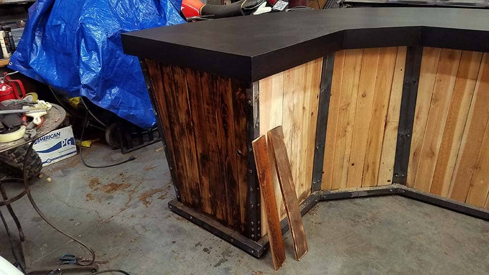 Wood stain test on side of new table built for BladeHQ