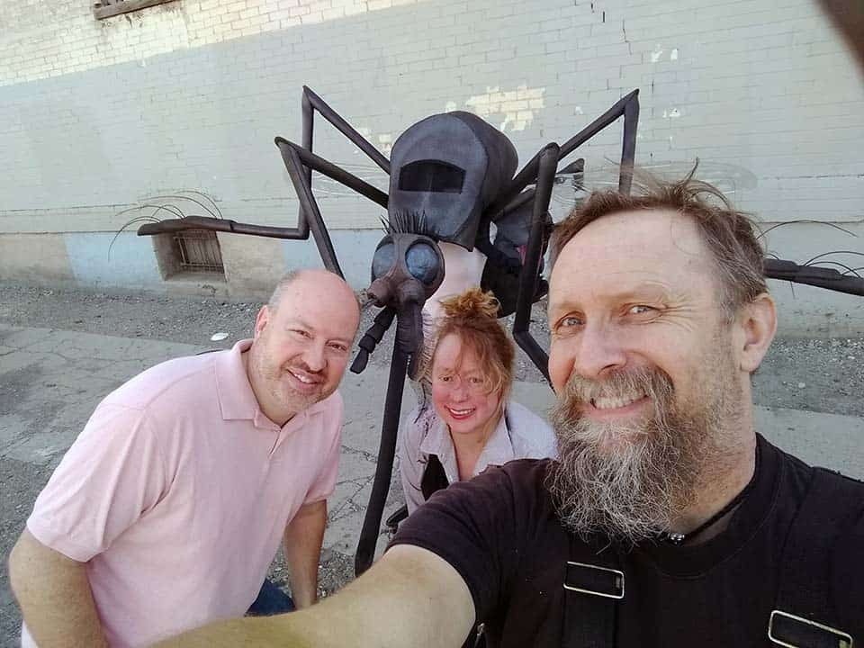Bryan Carter, Jennifer McGrew and Hraefn Wulfson in a selfie with new mosquito mascot costume
